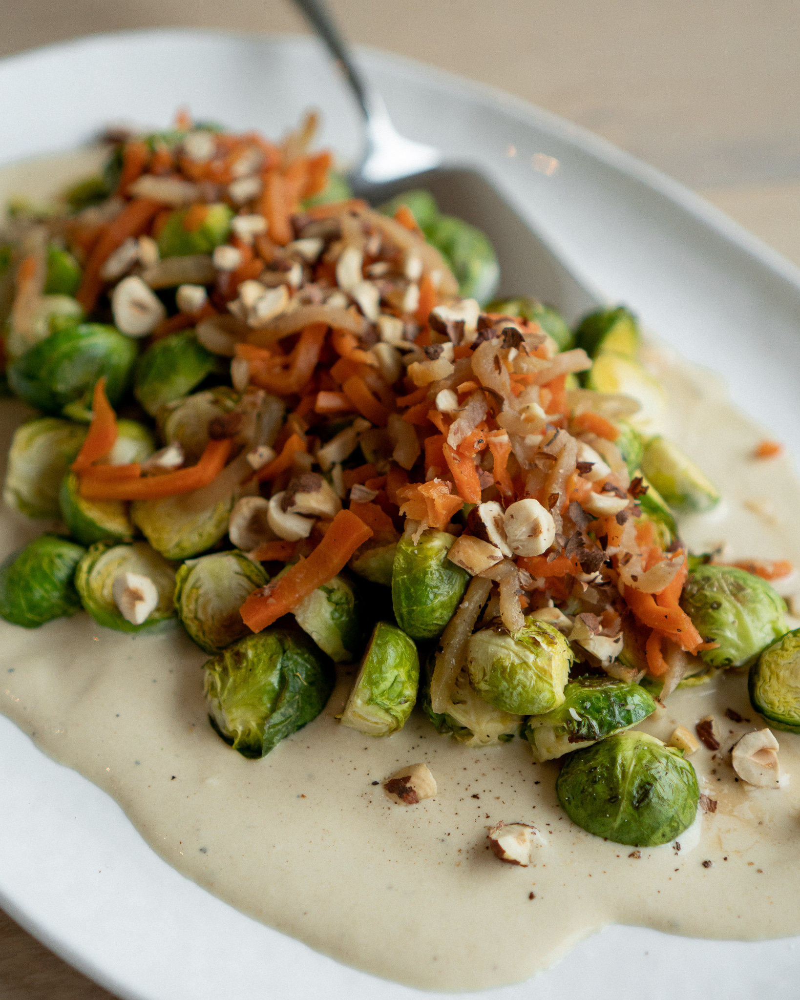 vegan roasted brussels sprouts with tahini sauce and dukkah